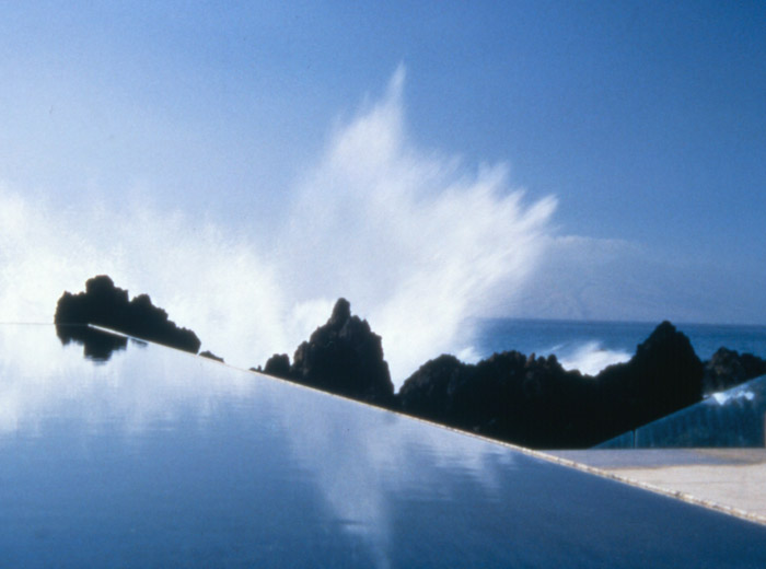 Makena House contemporary architecture infinity pool with crashing wave